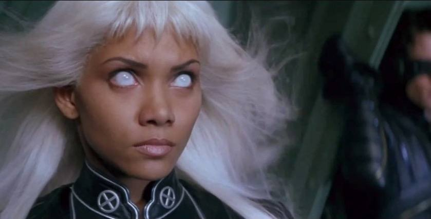 Halle Berry as Storm, with her eyes completely white, and looking off into the distance