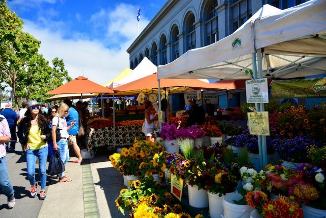 People selling and buying flowers at organic farmers market