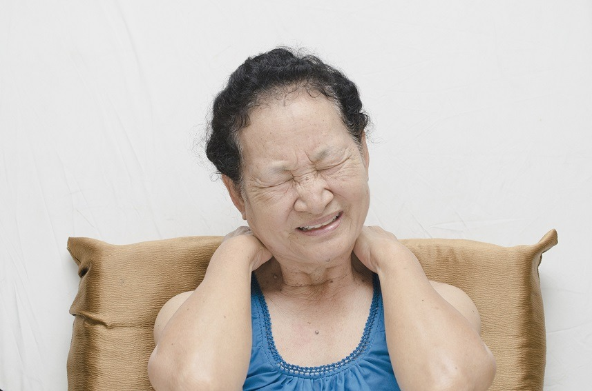 Senior woman experiencing pain in her head and neck