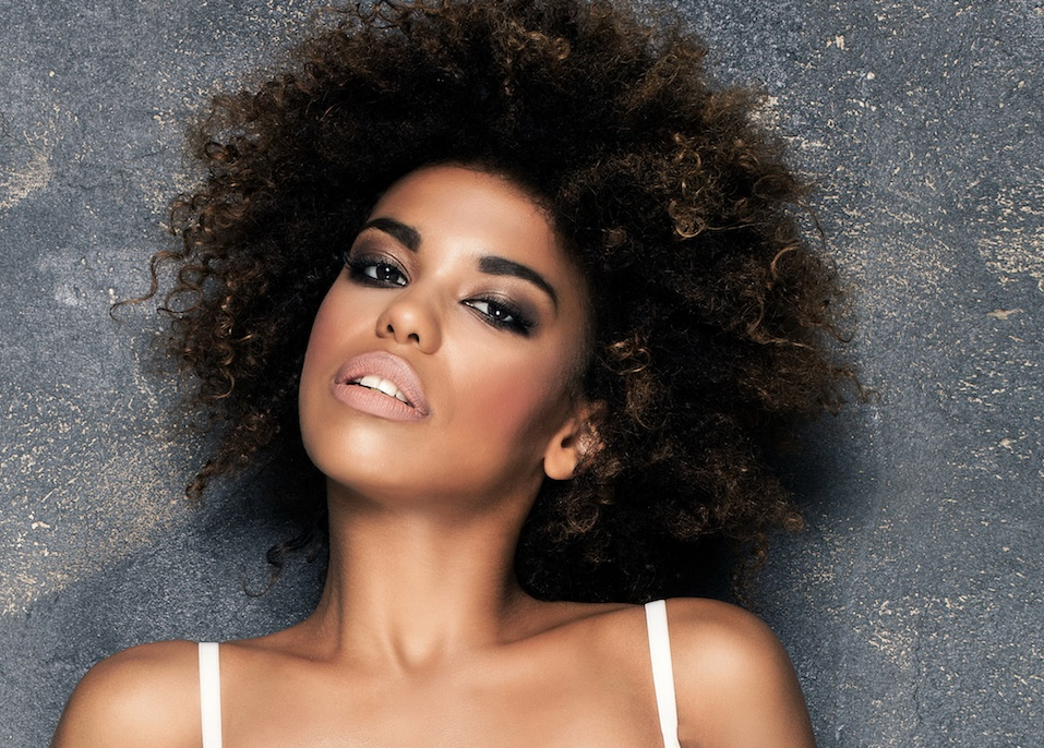 Girl with afro and glamour makeup