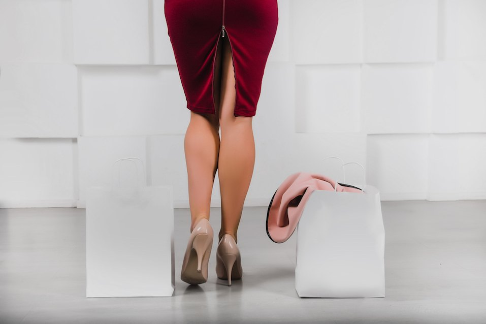 female legs peeking out of a pencil skirt from the back