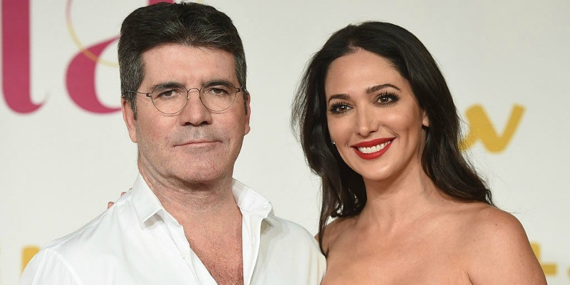 Simon Well and Lauren Silverman are posing together on the red carpet.