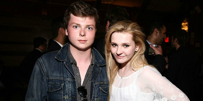 Spencer and Abigail Breslin pose together smiling.