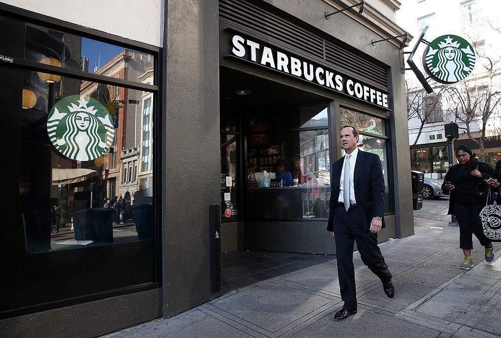 A pedestrian walks by a Starbucks Coffee shop