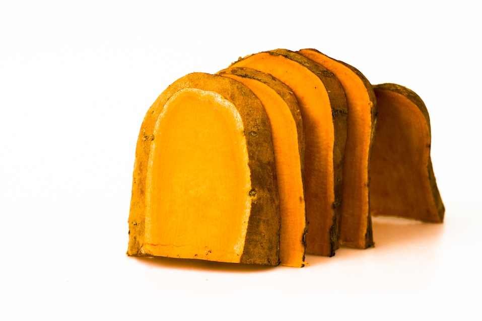 Slices of a large sweet potato arranged like toast in order to show possible low GI alternatives to high GI foods.