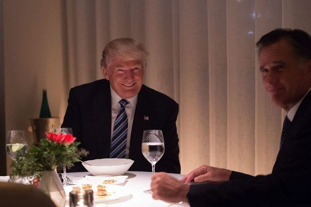 US President-elect Donald Trump (L) dines with Mitt Romney (R) at Jean-Georges restaurant