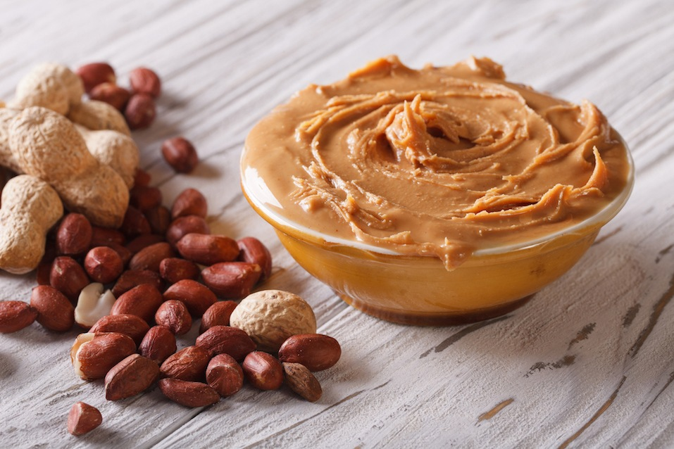 Tasty peanut butter in a bowl close up on the table