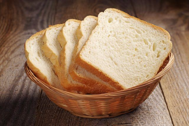 Toast bread on a brown basket.