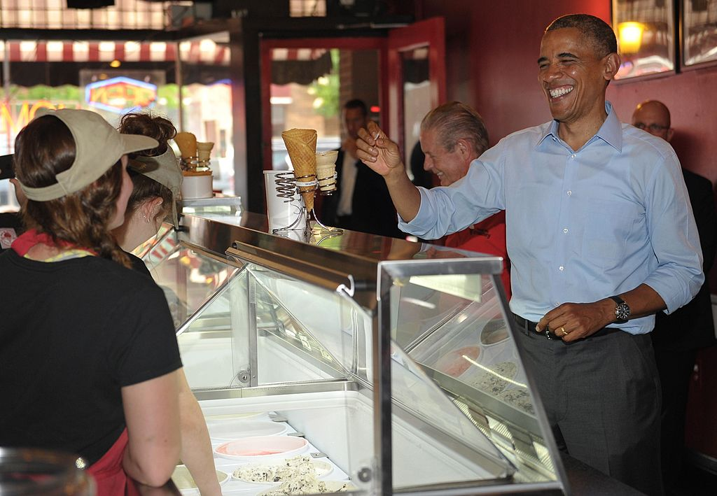 Obama talks to workers at an ice cream shop.
