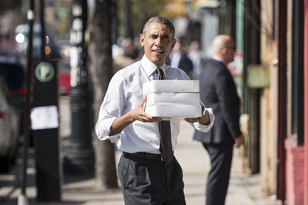 Barack Obama holding boxes of doughnuts