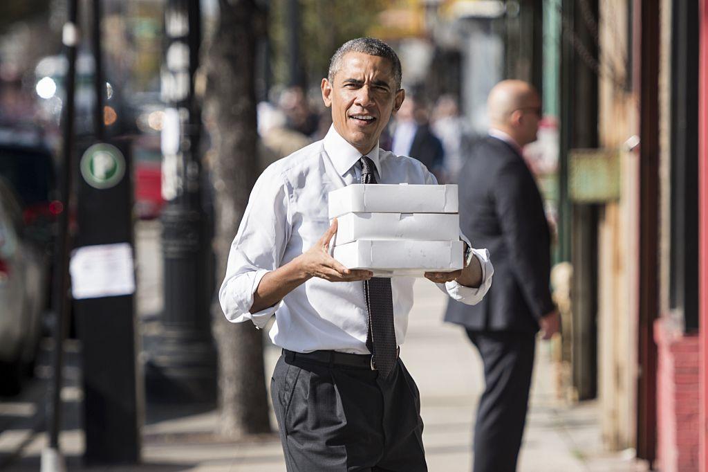 Barack Obama holding boxes of doughnuts