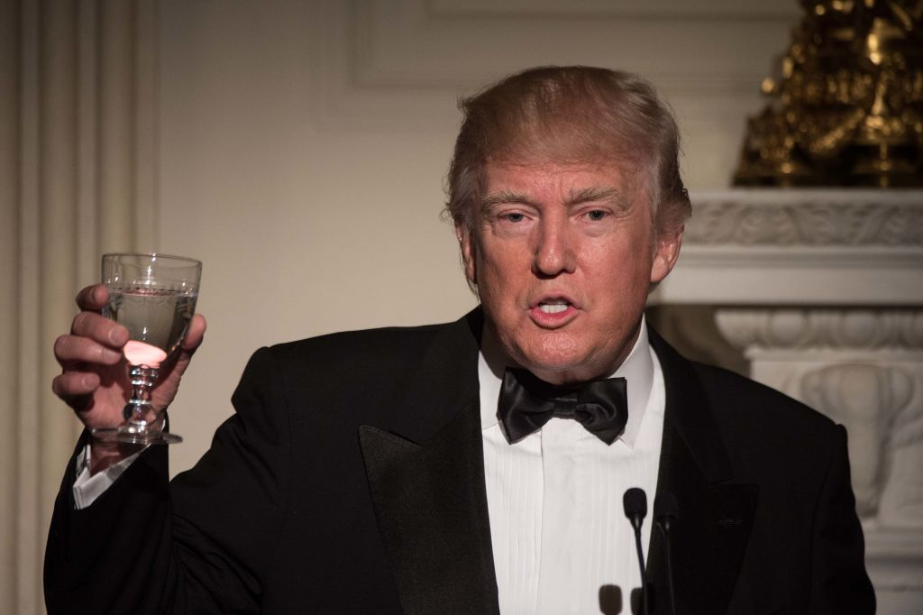 Donald Trump raises a glass for a toast