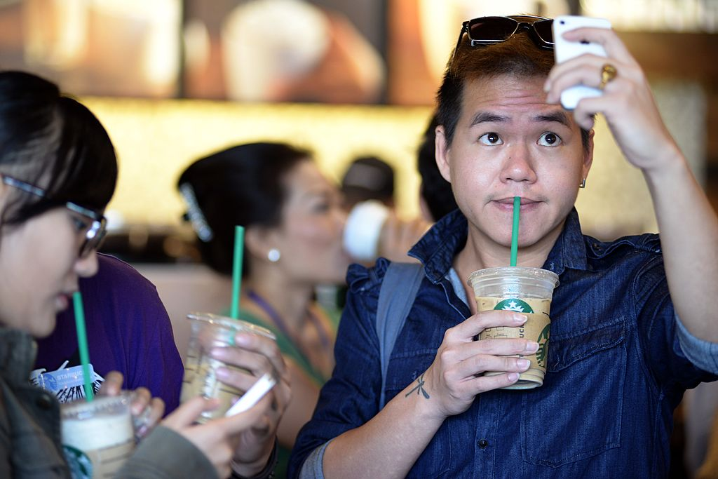 customers with starbucks drinks