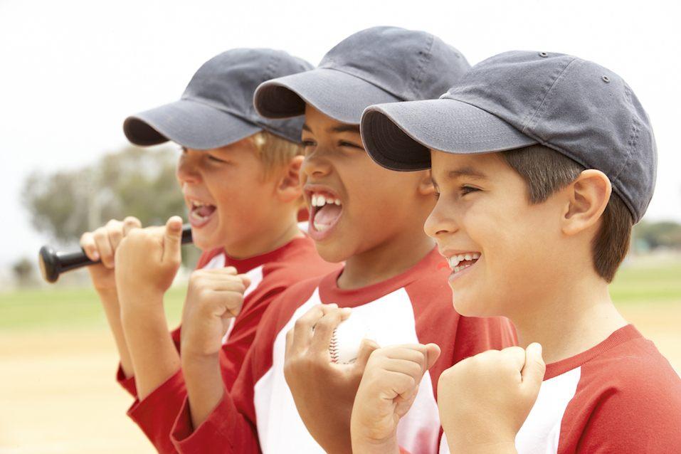 three boys in baseball uniforms