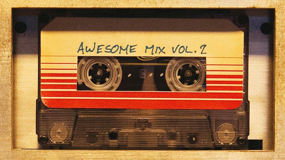 """A cassette tape reading """"Awesome Mix Vol. 2"""" on the label"""