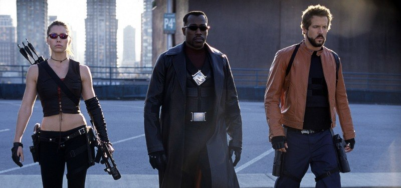 Blade, Abigial Whistler, and Hannibal are walking next to each other in a parking lot.