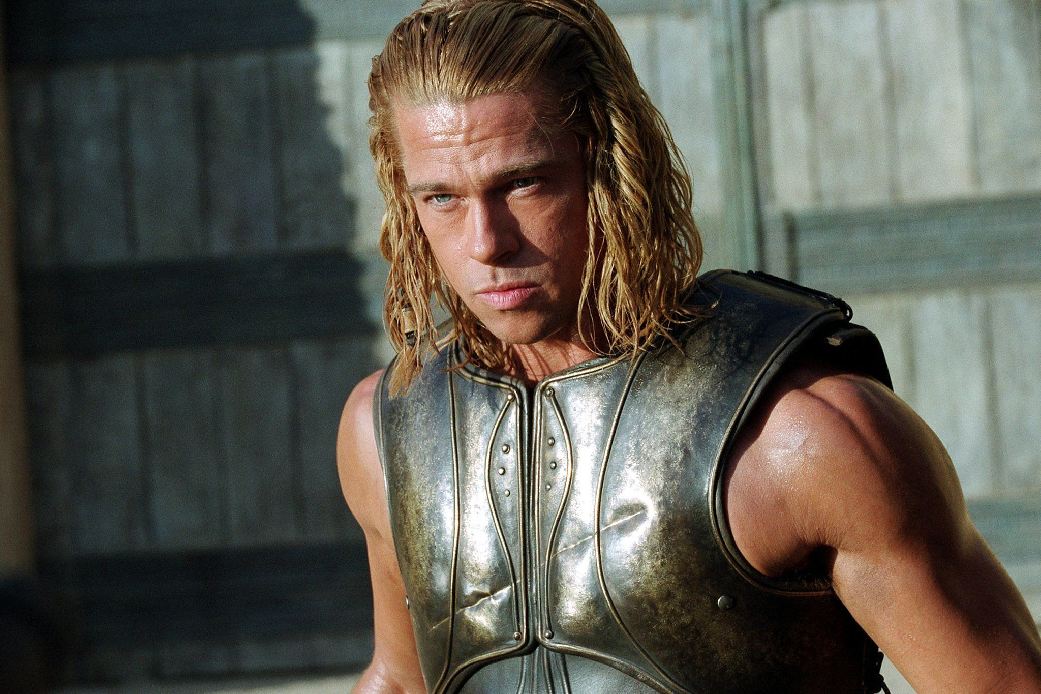Brad Pitt looking serious wearing armor in Troy