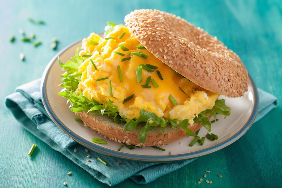 breakfast sandwich on bagel with egg cheese lettuce