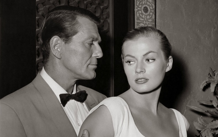 Black and white photo of Charles McGraw holds the arms of Anita Ekberg on 'Casablanca'