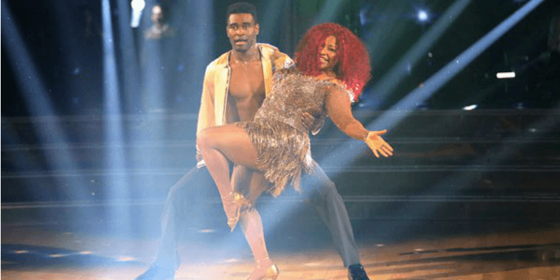 Chaka Khan is dipped by her partner on Dancing with the Stars.