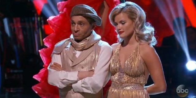 Chris Kattan and Witney Carson are standing and looking unhappy as they are eliminated.