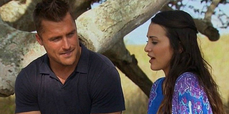 Chris Soules is talking to Andi Dorfman in a meadow by a tree