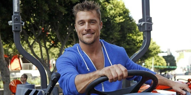 Chris Soules is smiling while on a tractor.