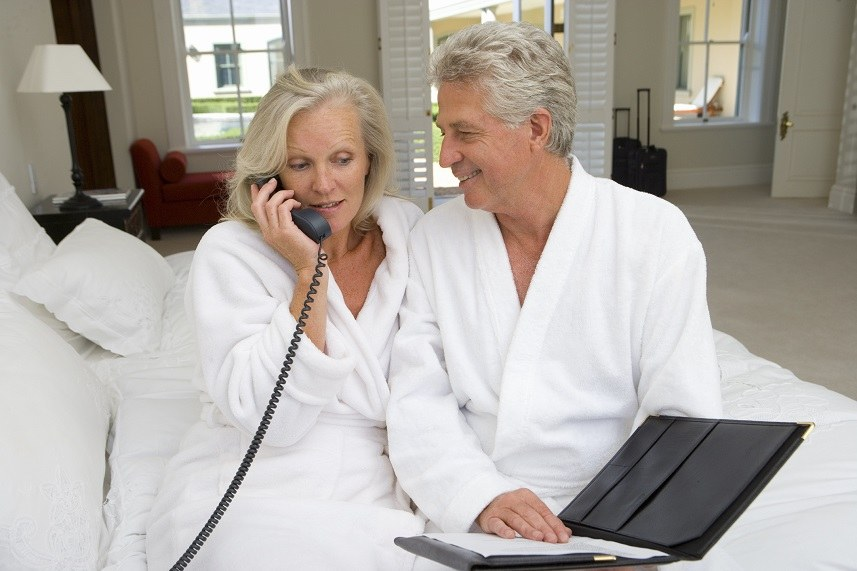 Mature couple sitting on bed