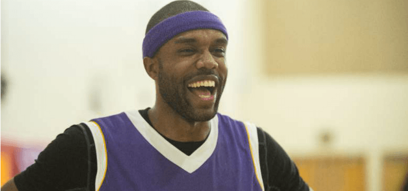 DeMario Jackson is in a purple jersey and has a purple headband on.