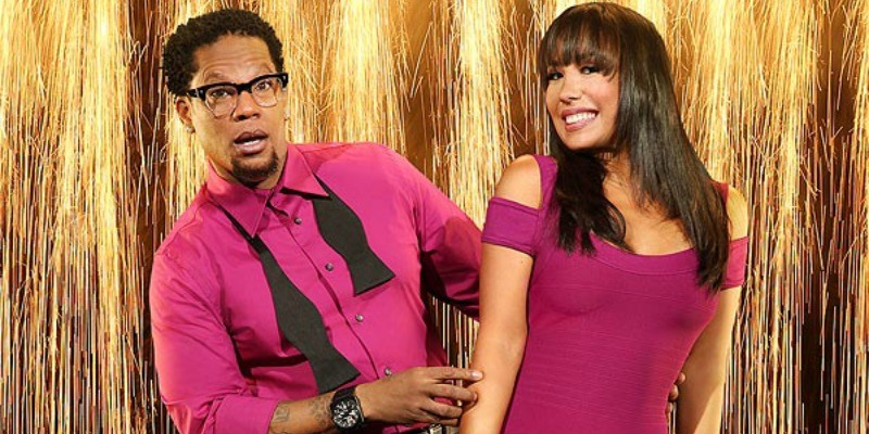 D.L. Hughley and Cheryl Burke are posing together on Dancing with the Stars.