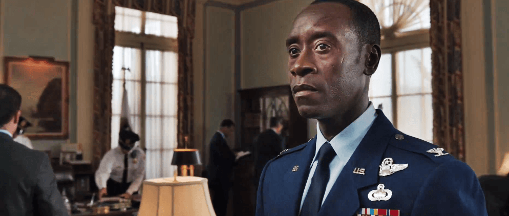 Don Cheadle, wearing a military uniform, looking off to the left of the frame
