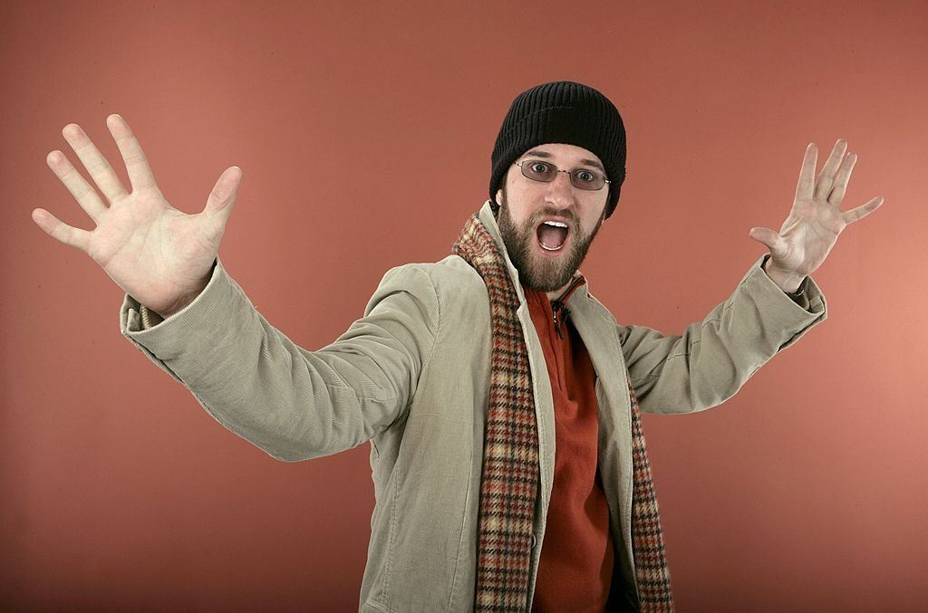 Dustin Diamond poses with his arms out