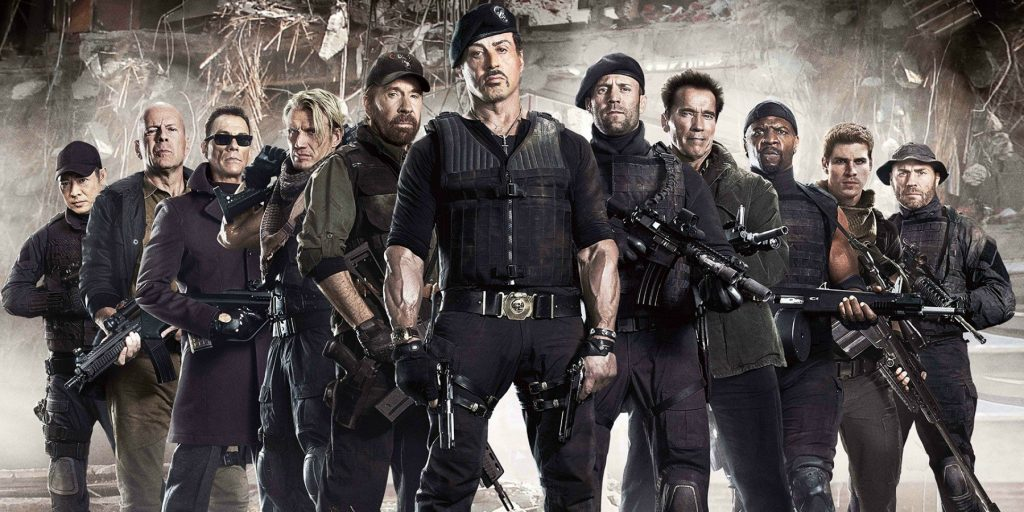 The cast of the Expendables dressed in all black, posing together for a promo photo