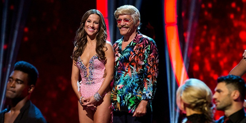 Geraldo Rivera is in a multicolored shirt next to Edyta Sliwinska who is in a pink bodysuit.