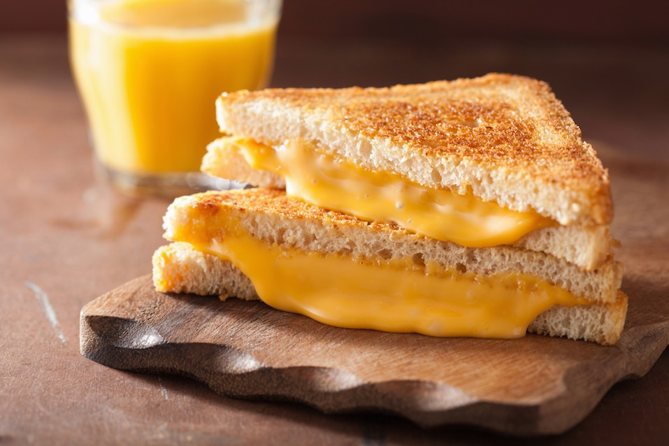 homemade grilled cheese sandwich on a wooden plate