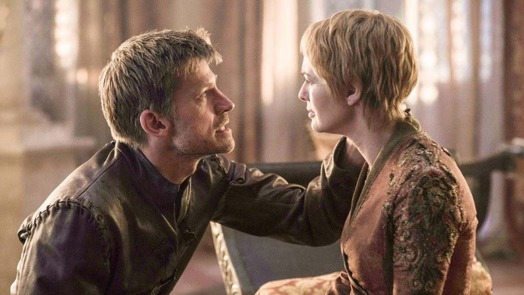 Jaime holding Cersei's head in his hand, kneeling in front of her as they look into each other's eyes