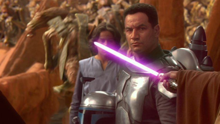 Jango Fett with his helmet off, as Mace Windu holds his purple lightsaber up to his neck threateningly