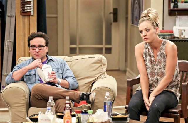 Leonard and Penny sit next to each other while eating Chinese food in 'The Big Bang Theory'.