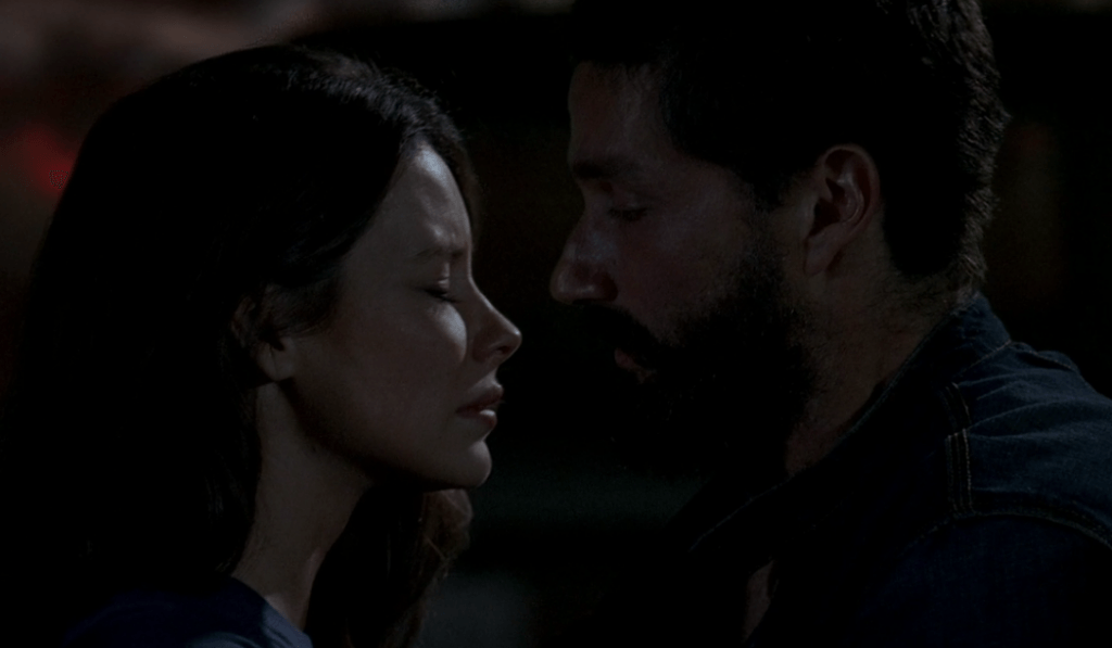 Evangeline Lilly and Matthew Fox looking at one another in Lost