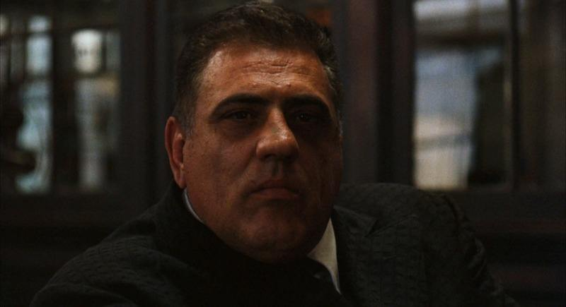 Luca Brasi looks into the camera on The Godfather