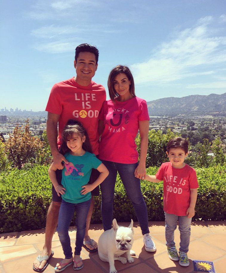 Mario Lopez, wife Courtney, and children Gia and Dominic and their dog standing on a mountain