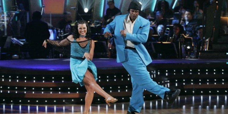 Master P and Ashly DelGrosso are kicking to one side on the dance floor in blue outfits.