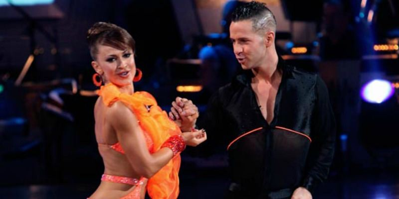 Mike Sorrentino and Karina Smirnoff are dancing together.
