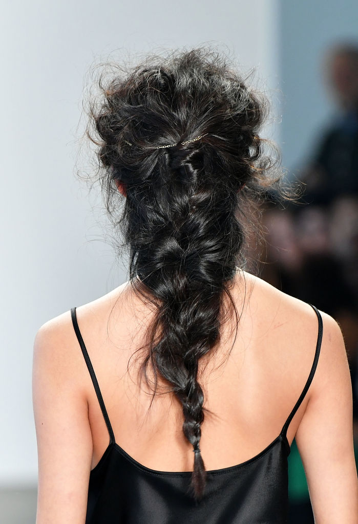A model, hair detail, walks the runway at Ane Amour fashion show