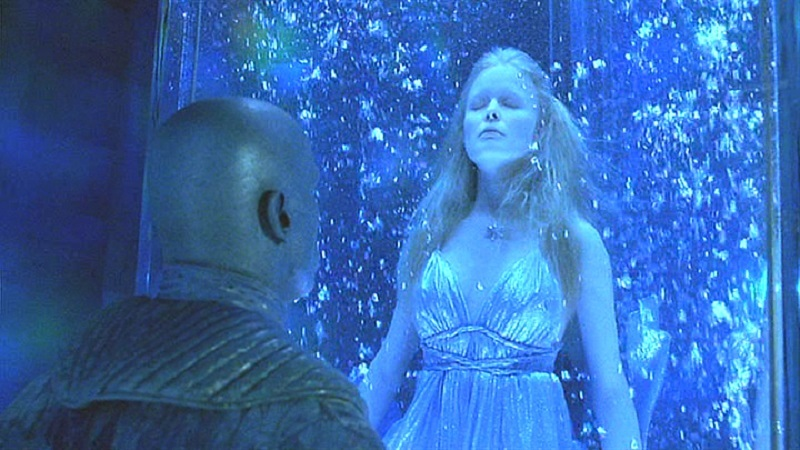 Arnold Schwarzenegger, as Mr. Freeze, looks at his frozen wife in 'Batman and Robin'