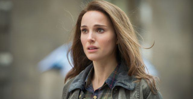 Jane Foster, wearing a jacket, and looking concerned off into the distance.