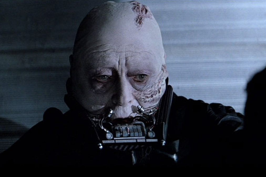 Darth Vader with his helmet off, with scars across his head and below his cheeks