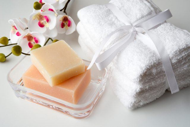 orchid, white towels and soaps