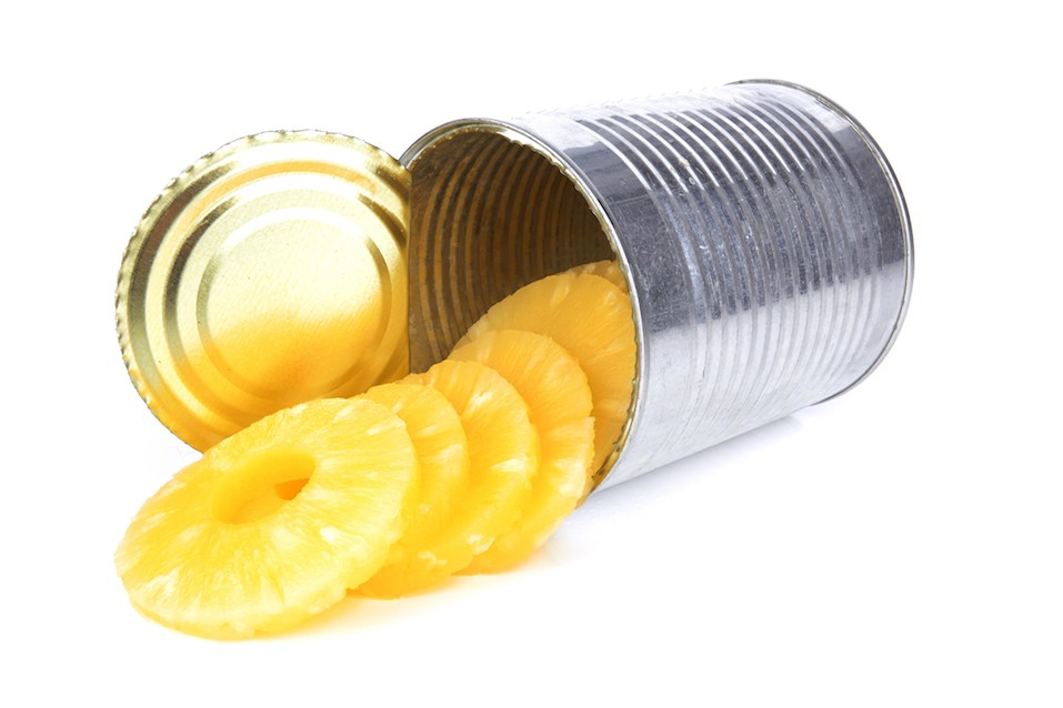 Portion of canned sliced pineapple isolated on white background