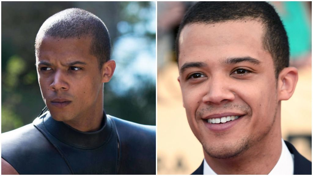 A side-by-side comparison of Jacob Anderson as Grey Worm in Game of Thrones, and wearing a suit, smiling on the red carpet